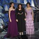 Ashley Judd, Annabella Sciorra, and Salma Hayek onstage at the 90th Academy Awards ceremony
