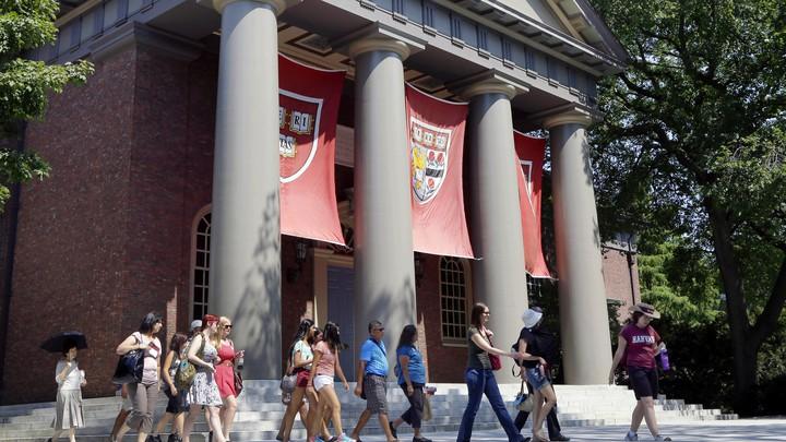 A campus tour walks through the Harvard campus.