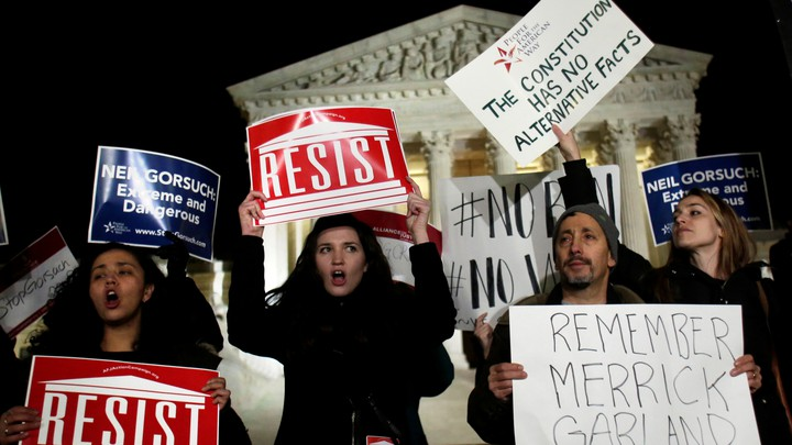 Demonstrators gather outside the Supreme Court building to protest President Donald Trump's appointment of Neil Gorsuch