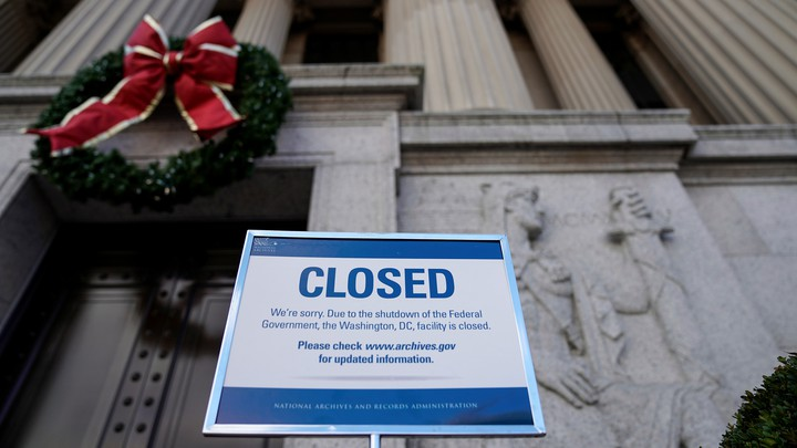 A sign declares the National Archive is closed because of a partial federal-government shutdown in Washington.