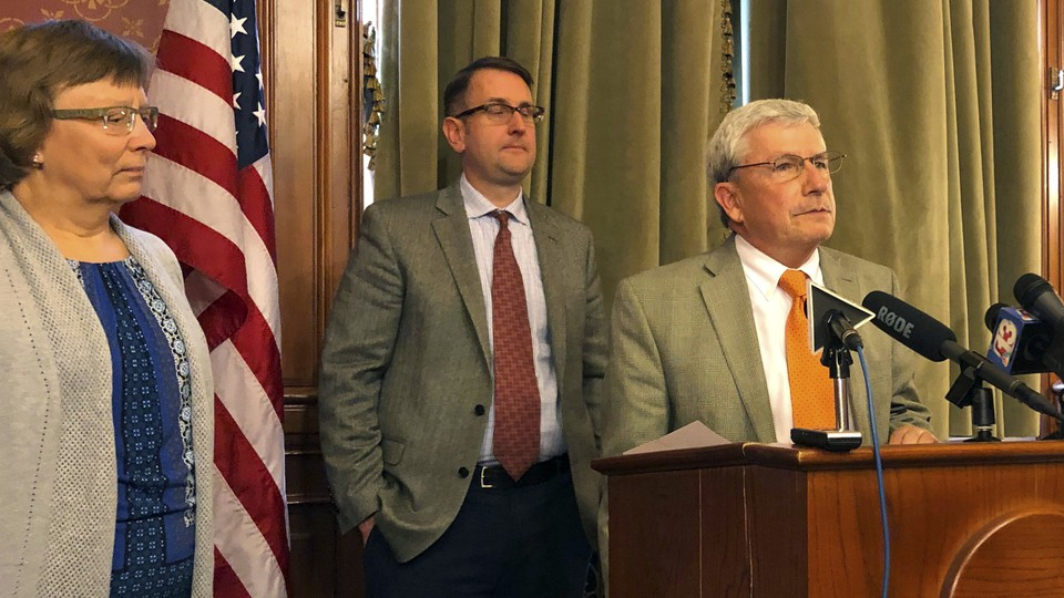 Andy McKean, right, the longest-serving Republican in the Iowa legislature, announced that he's becoming a Democrat during a news conference on April 23, 2019.