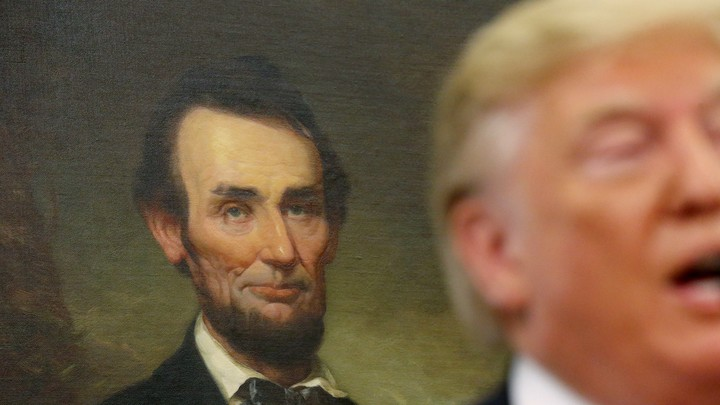 Donald Trump with Abraham Lincoln behind him.