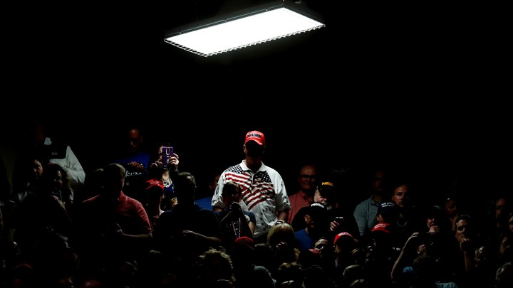 Supporters of U.S. President Donald Trump wait for him to appear for a rally
