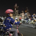 A girl sits on her bicycle as she looks at other cyclists in Mexico City's Zocalo Square May 29, 2010.
