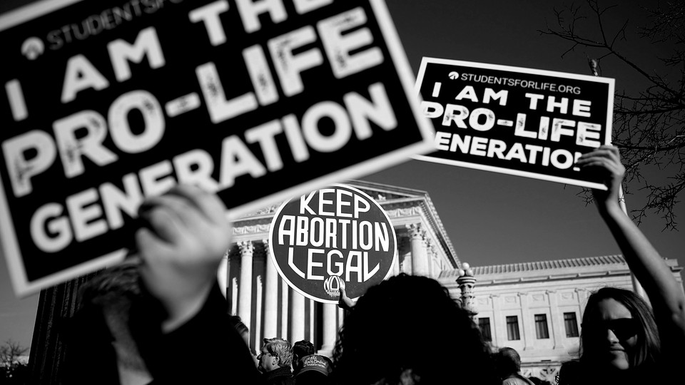 Anti-abortion-rights signs at a protest