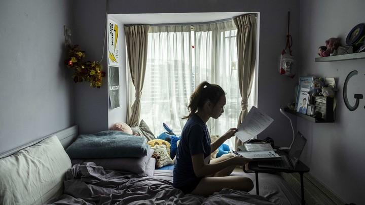 A high schooler in Hong Kong working on homework.
