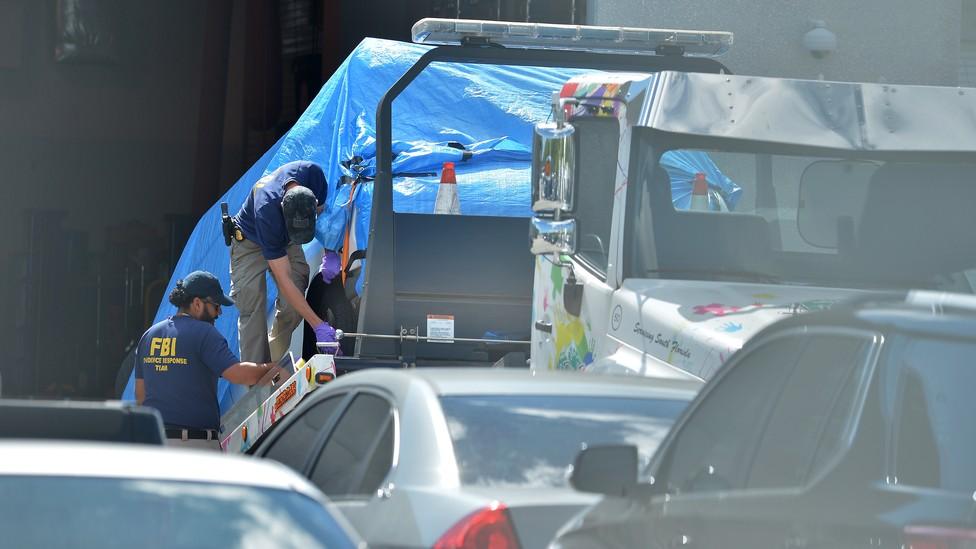 Investigators bring Cesar Sayoc's car to an FBI facility in Miramar, Florida.