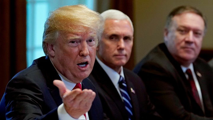 Vice President Mike Pence and Secretary of State Mike Pompeo listen as President Trump speaks during a meeting.