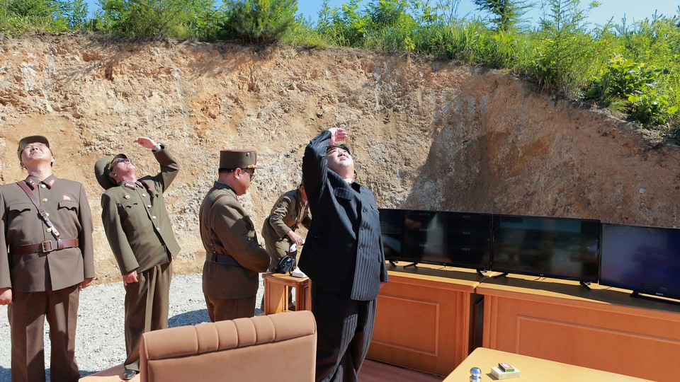 North Korean leader Kim Jong Un looks on during the test-launch of the intercontinental ballistic missile Hwasong-14 in an undated photo released by North Korea's Korean Central News Agency (KCNA).