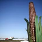 A metal sculpture in the shape of a corn cob near a road in Iowa City, Iowa.