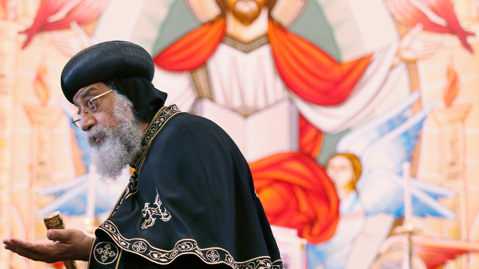 Coptic Pope Tawadros II visits a church in Australia.