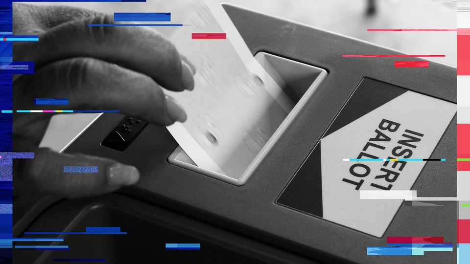 A woman inserts her ballot into an intake machine in Los Angeles, in 2012.