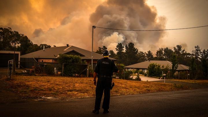 Bushfires approach homes near Sydney, Australia.