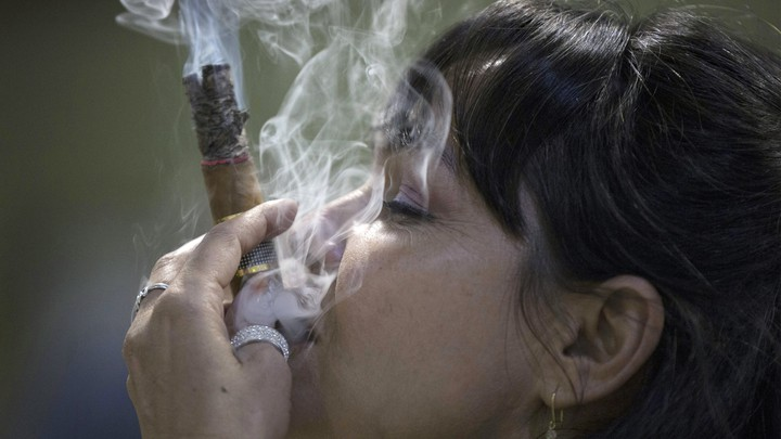 Cigar sommelier Ivonne de La Puente, 47, smokes a cigar during the XVII Habanos Festival in Havana, February 23, 2015.