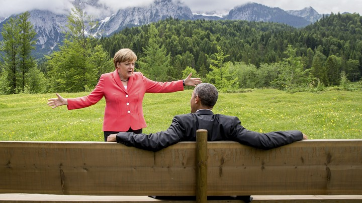 Chancellor Angela Merkel speaks with President Barack Obama outside the Elmau castle in Kruen near Garmisch-Partenkirchen, Germany.