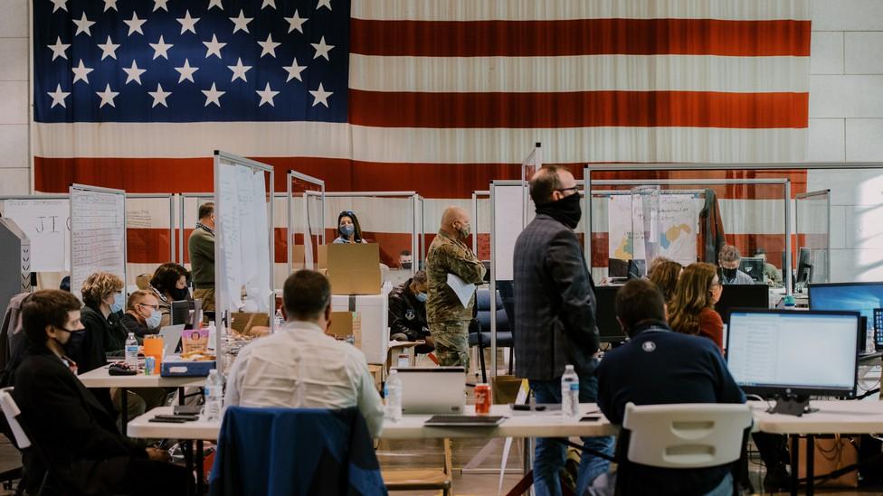 Members of a coronavirus vaccine task force met in a command center in Charleston, West Virginia.