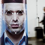 a photo of a poster representing facial recognition at a security conference in Beijing, China, which has aggressively invested in the controversial technology.