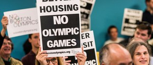 """In Boston, protestors hold signs reading """"Better Housing, No Olympic Games"""""""