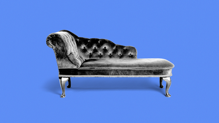A picture of a therapist's couch against a blue background