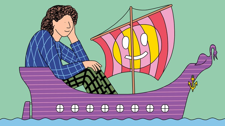 A person rides in a small purple ship with a smiley face on the sail.