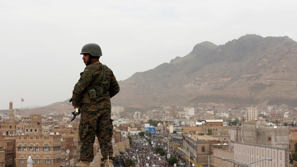 A Houthi soldier overlooking demonstrations in Sanaa, Yemen.