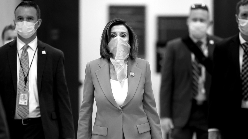 Nancy Pelosi wearing a scarf over her face.