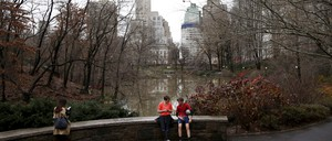 People sit to rest in Central Park in New York City.