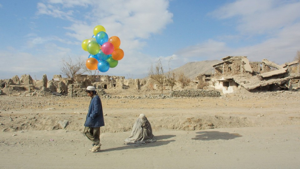 Boy selling balloons in Kabul in the early 1990's.