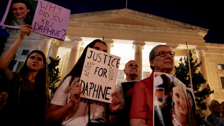 """Caruana Galizia's family members protest at Malta's Courts of Justice in August. Signs say """"Justice for Daphne"""" and """"Why did you kill Daphne?"""""""