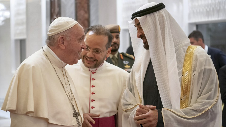 Pope Francis is welcomed by Crown Prince Mohammed bin Zayed al-Nahyan upon his arrival in Abu Dhabi on February 3, 2019.