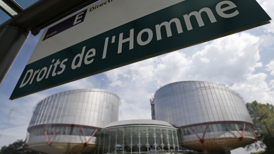 """A board reads """"Human rights"""" in front of the European Court of Human Rights in Strasbourg"""