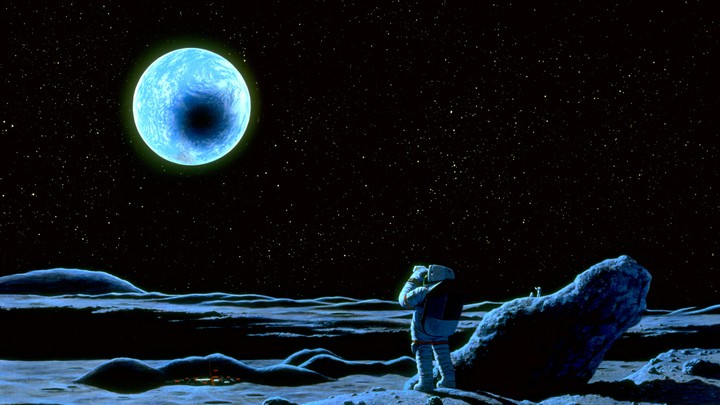 A person on the moon in a space suit watches the Earth pass in front of the sun.