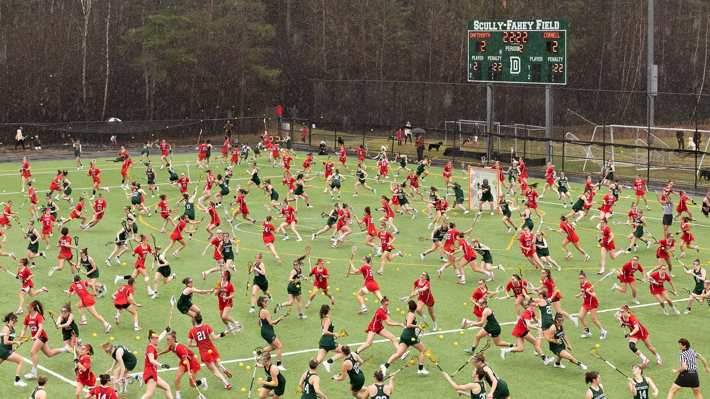 photo illustration of overcrowded women's lacrosse field