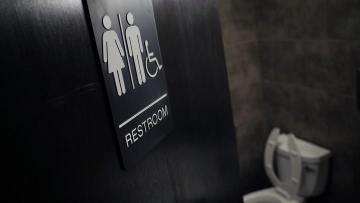 The door to a public bathroom in a coffee shop