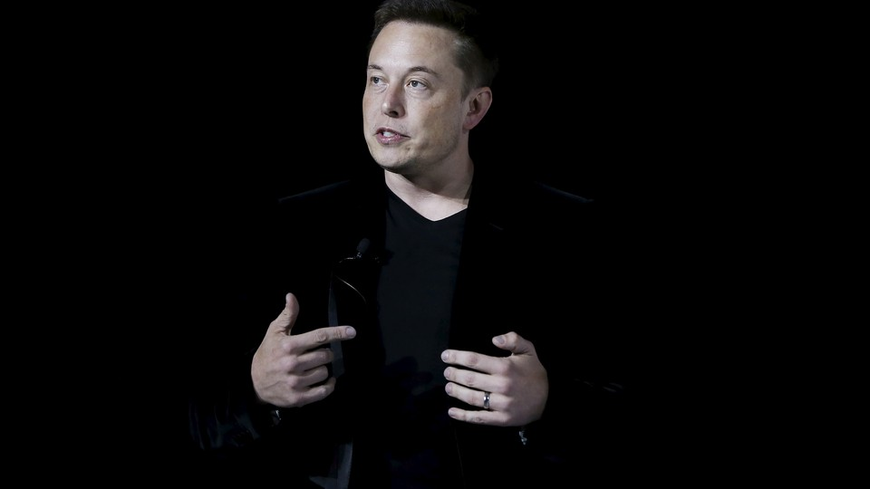 Elon Musk speaking at a presentation in 2015