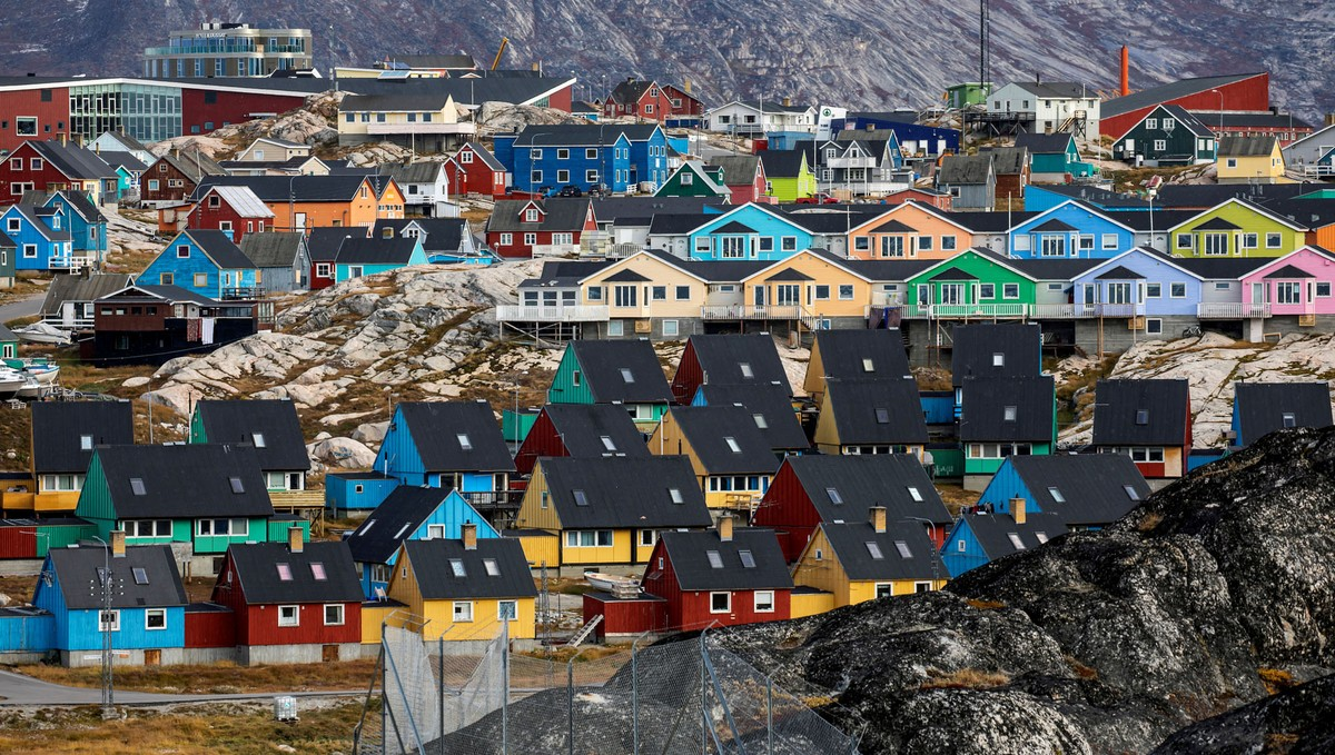A view of colorful houses clustered together on rocky land