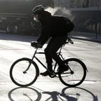 a photo of a Minneapolis bike rider in winter