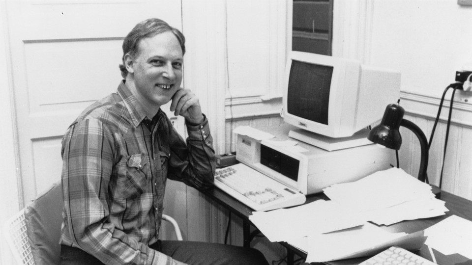 John James sits at a computer in the 80s