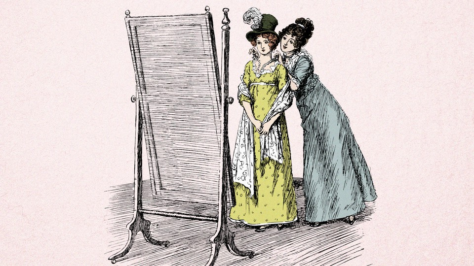 two women looking in the mirror
