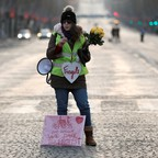 """A photo of a """"yellow vest"""" protester in Paris, where high gas taxes have contributed to a wave of unrest."""