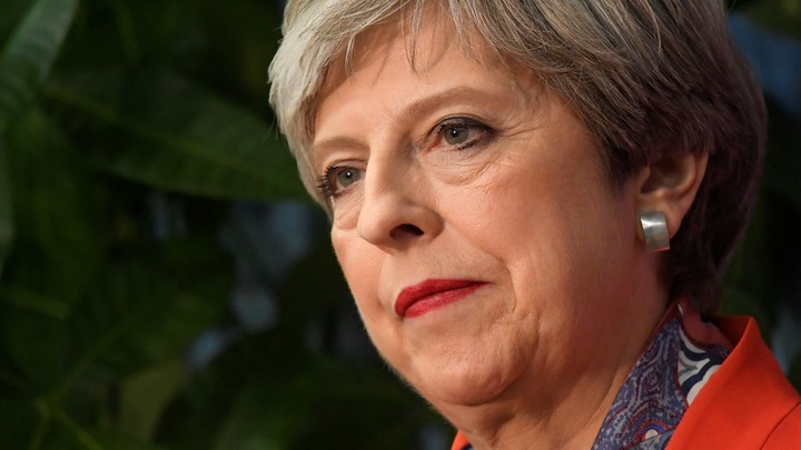 Prime Minister Theresa May waits to speak after retaining her seat.