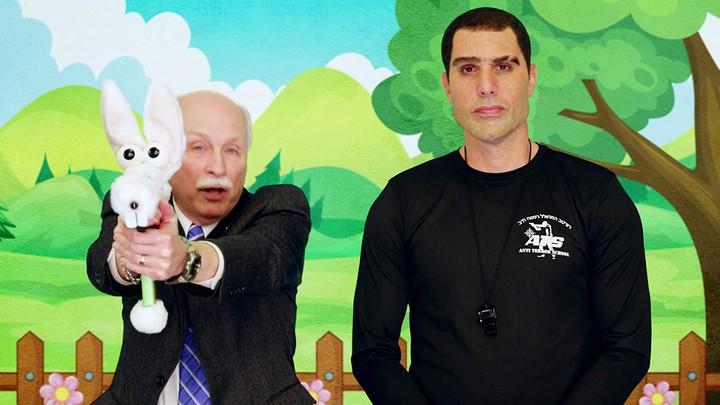 Sacha Baron Cohen, in character as Israeli pro-gun advocate Colonel Erran Morad, with Philip Van Cleave
