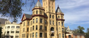 The central building of a former mental hospital in Fergus Falls, Minnesota, features turrets and a central tower.