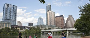 Cyclists and walks use a trail beside Lady Bird Lake in Austin, Texas.