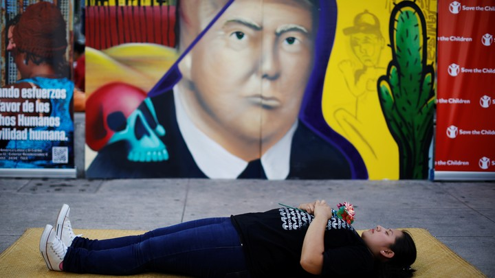 A woman pays homage to undocumented migrants from El Salvador and their journey to the U.S.