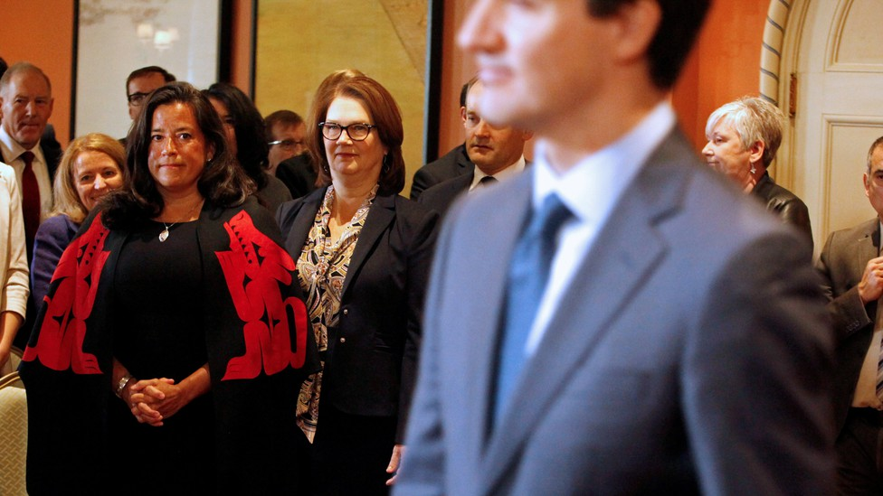 Jody Wilson-Raybould and Jane Philpott watch Justin Trudeau announce the shuffling of his cabinet ministers on January 14.