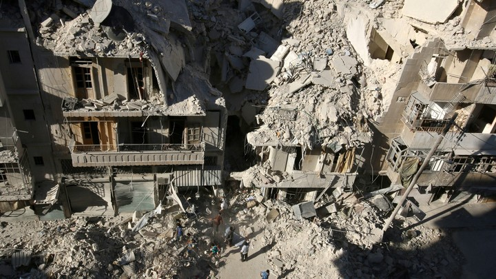 Damaged buildings in the rebel-heldTariq al-Bab neighborhood of Aleppo, Syria.