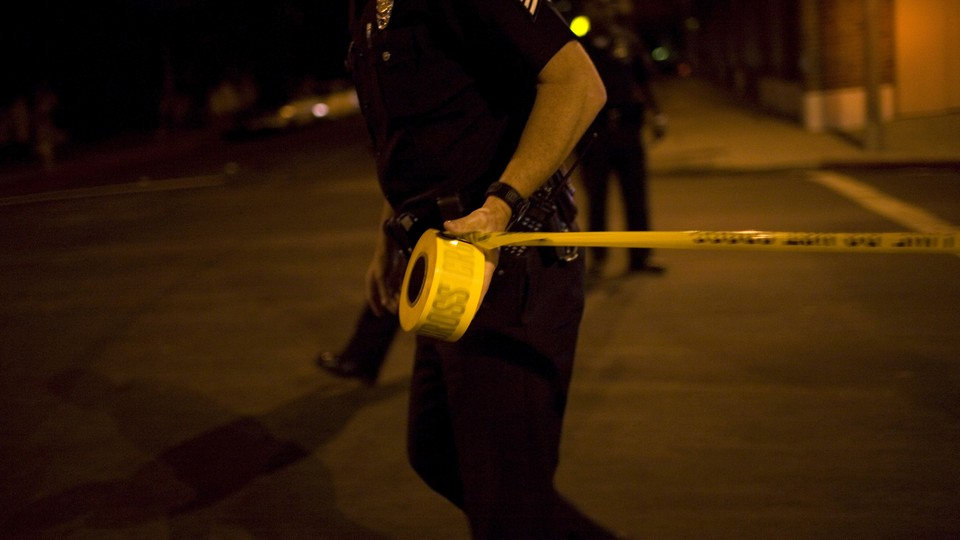 A police officer with caution tape.