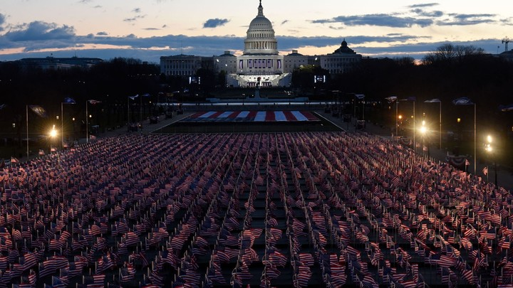 American flags decorate the National Mall near the U.S. Capitol in the early morning ahead of the inauguration of President-elect Joe Biden, on January 20, 2021, in Washington, D.C.