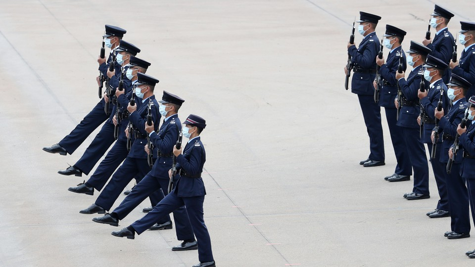 Goose-stepping police officers